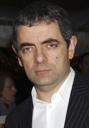 "FILE -- British actor and comedian Rowan Atkinson, seen in this Thursday Nov. 6, 2003 file photo, is recovering in hospital in Peterborough, England, Friday Aug. 5, 2011, after crashing his sports car.  Atkinson, famed for his hapless driving in the ""Mr. Bean"" television shows and films, was involved in a road accident late Thursday, but did not disclose details of his minor injuries. Atkinson was driving his McLaren F1 supercar - one of the world's fastest road cars -  when he crashed, striking a tree and a lamppost before the vehicle caught fire, authorities said.(AP Photo/Jennifer Graylock, file)"