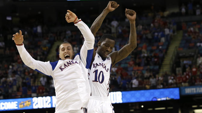 Kansas guard Tyshawn Taylor (10) celebrates with Kansas guard Christian Garrett at the end of an NCAA Final Four semifinal college basketball tournament game against Ohio State Saturday, March 31, 2012, in New Orleans. Kansas won 64-62. (AP Photo/David J. Phillip)