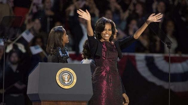: Malia Obama and first lady Michelle Obama appear after Obama's victory speech on election night at McCormick Place on November 6, 2012 in Chicago -- Getty Images