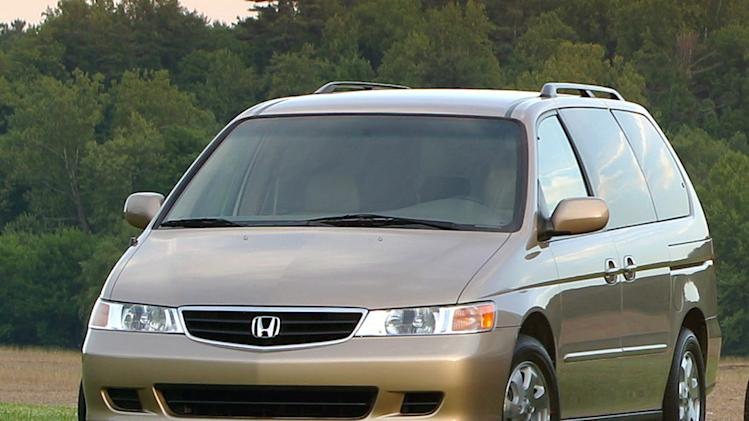 FILE - A 2003 Honda Odyssey is shown in an undated Honda Motor Company file photo. U.S. safety regulators have added about 320,000 older model Honda Odyssey minivans to a widening probe of faulty air bags that affects at least three automakers and more than 2 million vehicles. Front air bags on the Honda Motor Co. minivans from the 2003 and 2004 model years can inflate without a crash, possibly injuring drivers and passengers. (AP Photo/Honda Motor Company, File)