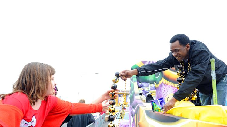 IMAGE DISTRIBUTED FOR FOX SEARCHLIGHT - Dwight Henry, star of the Academy Award nominated film Beasts of the Southern Wild, hands out beads in the Argus parade on Mardi Gras on Tuesday, Feb. 12, 2013 in Metairie, La. (Photo by Cheryl Gerber/Invision for Fox Searchlight Pictures/AP Images)