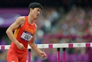 China's Liu Xiang leaves the track after falling ang injuring himself in the men's 110m hurdles heats at the athletics event during the London 2012 Olympic Games. Liu endured a dreadful repeat of his Beijing Olympics heartbreak as he suffered a suspected ruptured Achilles tendon