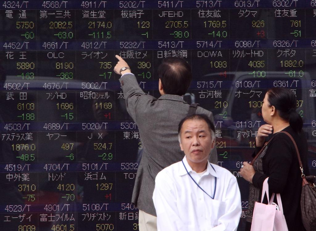 Asian shares down as Wall St. tumbles on poor data