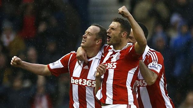 Charlie Adam celebrates scoring for Stoke (Reuters)