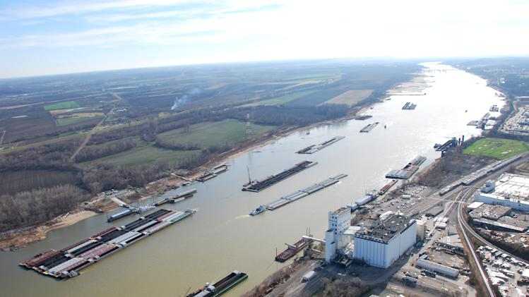 This Dec. 5, 2012 photo provided by The United States Coast Guard shows barges passing in tight quarters due to low water levels as they navigate the Mississippi River near St. Louis. In a letter obtained by The Associated Press Thursday, Dec. 6, 2012, Army Assistant Secretary Jo-Ellen Darcy, a top Army Corps official, turned back requests by federal lawmakers and the barge industry to release more of the Missouri River it is withholding, believing the drought-starved Mississippi River the Missouri feeds still will remain open to shipping despite mounting concerns. (AP Photo/United States Coast Guard, Colby Buchanan)