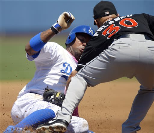 Capuano, Van Slyke lead Dodgers over Marlins 5-3