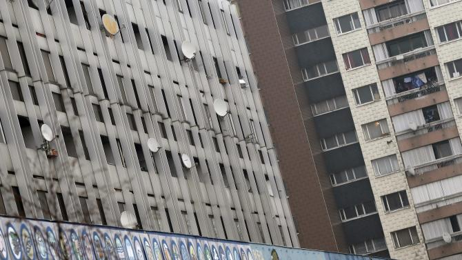 Television satellite dishes are seen on council housing blocks in Aulnay-sous-Bois