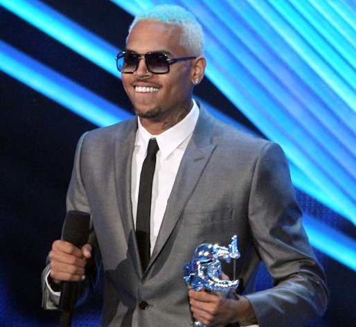 "FILE - In this Sept. 6, 2012, file photo, Chris Brown accepts the award for best male video for ""Turn Up the Music"" at the MTV Video Music Awards in Los Angeles. Brown is scheduled to return to a Los Angeles courtroom on Monday, Sept. 17, 2012, for the first time in more than a year amid questions about his community service. (Photo by Matt Sayles/Invision/AP, File)"