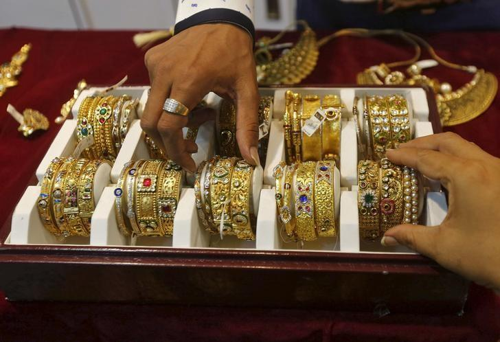 India gold futures rise to near 2-year high on global cues, weaker rupee