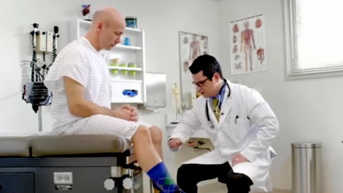 In this image from video provided by Wellmark Blue Cross and Blue Shield, a man kicks the wrong leg as a doctor checks his reflexes in an ad from the Midwestern insurer. Wellmark launched ads recently in Iowa and South Dakota poking fun at technical problems that have plagued the federal government's insurance enrollment website while trying to lure away some potential customers. (AP Photo/Wellmark Blue Cross and Blue Shield)