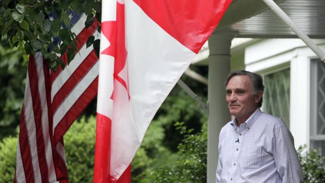 World Trade Center survivor Brian Clark is photographed at his home in Mahwah, N.J., Thursday, June 23, 2011.  Clark worked at Euro Brokers on the 84th floor of the south tower of the World Trade Center. (AP Photo/Richard Drew)