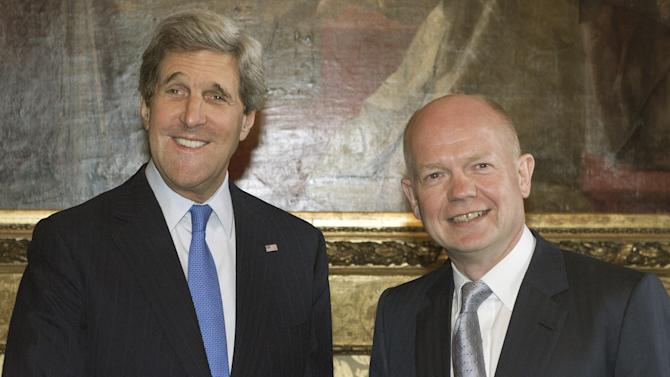 British Foreign Secretary William Hague, right, greets US Secretary of State John Kerry ahead of a meeting in the Foreign and Commonwealth Office in central London, Wednesday April 10, 2013. Kerry is meeting in London with Syrian opposition leaders and Russia's top diplomat, a day after saying the U.S. could soon step up aid to rebels fighting Syrian President Bashar Assad's regime.  Kerry is in London for a G8 foreign ministers' meeting today and Thursday. (AP Photo/Paul J. Richards, pool)