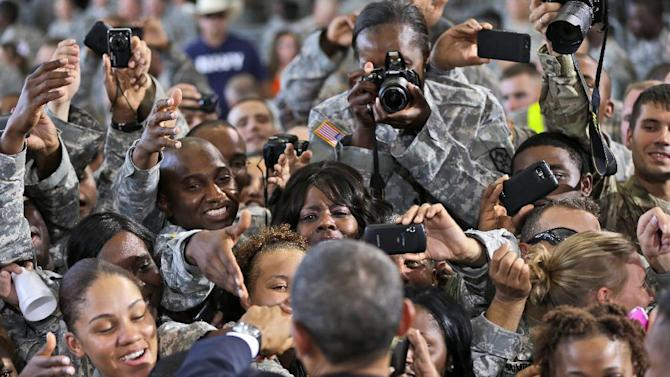 President Barack Obama greets members of the military and their families after speaking at Fort Bliss, Friday, Aug. 31, 2012, in El Paso, Texas. (AP Photo/Pablo Martinez Monsivais)
