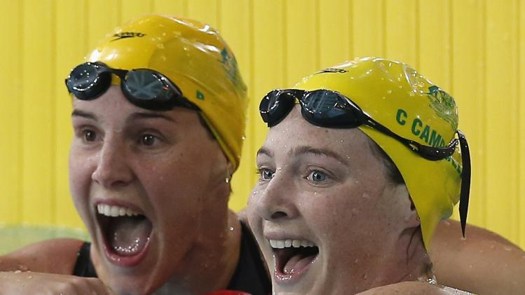 Australia's gold medalist Cate Campbell celebrates with silver medalist compatriot Bronte Campbell after the women's 100m Freestyle final at the 2014 Commonwealth Games in Glasgow