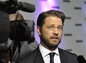Actor Jason Priestley is interviewed on the red carpet at the 26th Gemini Awards in Toronto
