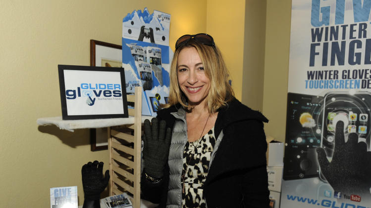 Actress Judi Beecher visits the Glider Gloves booth at the Fender Music lodge during the Sundance Film Festival on Monday, Jan. 21, 2013, in Park City, Utah. (Photo by Jack Dempsey/Invision for Fender/AP Images)