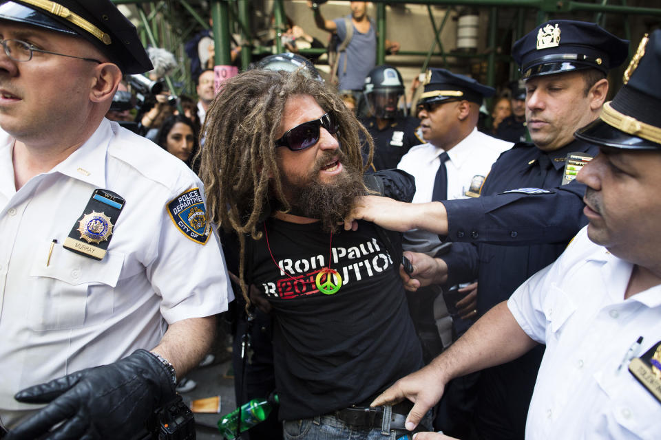 A.J. Redkey is arrested during an Occupy Wall Street march, Monday, Sept. 17, 2012, in New York. A handful of Occupy Wall Street protestors have been arrested during a march toward the New York Stock Exchange on the anniversary of the grass-roots movement. (AP Photo/John Minchillo)