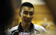 Malaysia badminton star Lee Chong Wei, pictured on July 6 had his Olympic dream threatened by a serious ankle injury. He is now targeting a medal in a campaign fuelled by porridge and hot soup