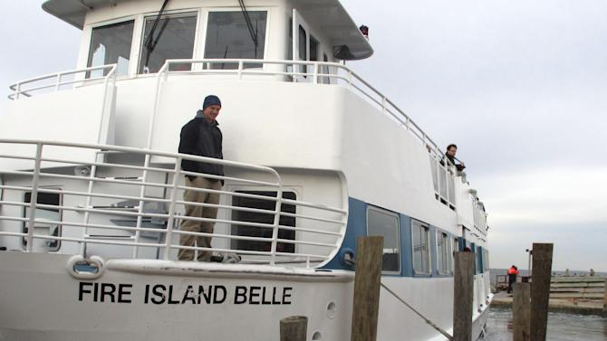 In this Friday, Nov. 16, 2012 photo, the ferry Fire Island Belle leaves the dock with passengers visiting Ocean Beach, N.Y. Residents of the Fire Island community were allowed to visit to assess damage from Superstorm Sandy. (AP Photo/Frank Eltman)