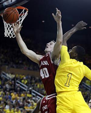 Indiana forward Cody Zeller (40) looses the ball against the defense from Michigan forward Glenn Robinson III (1) during the first half of an NCAA college basketball game Sunday, March 10, 2013, in Ann Arbor, Mich. (AP Photo/Duane Burleson)