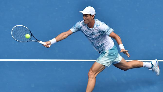 Tomas Berdych of the Czech Republic hits a return against Bernard Tomic of Australia in their men's singles match at the Australian Open tennis tournament in Melbourne on January 25, 2015