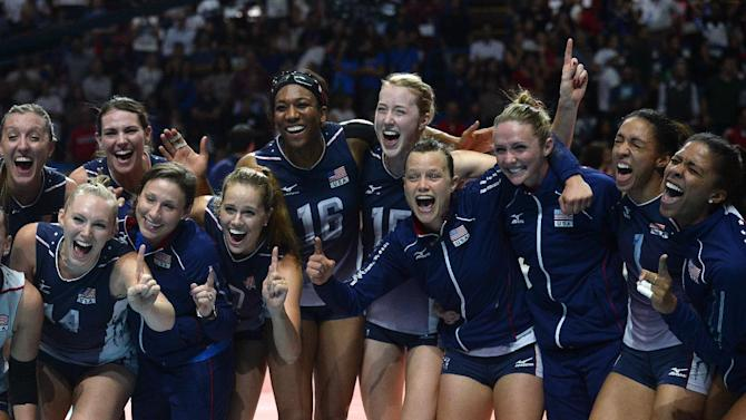 US players celebrate after winning the volleyball women's world championship final match USA vs China in Milan on October 12, 2014