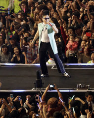 FILE - South Korean rapper PSY, who sings the popular &quot;Gangnam Style,&quot; performs during his concert in front of Seoul City Hall in Seoul, South Korea, in this, Oct. 4, 2012 file photo. YouTube says in a posting on its Trends blog that &quot;Gangnam Style&quot; had been viewed 805 million times as of Saturday afternoon, Nov. 24, 2012 surpassing Justin Bieber&#39;s &quot;Baby,&quot; which has had 803 million views to become YouTube&#39;s most viewed video of all time.. (AP Photo/Lee Jin-man, File)
