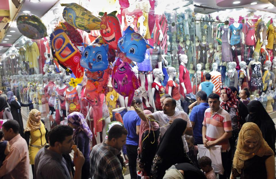 Egyptian crowd for shopping to mark Eid el-Fitr holiday, which caps the Muslim fasting month of Ramadan, in Cairo, Egypt late Wednesday, Aug. 15, 2012.  (AP Photo/Amr Nabil)