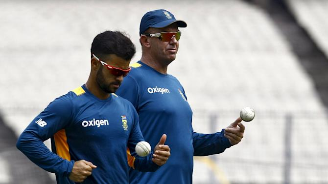 South Africa's Duminy and a coaching staff member attend a practice session ahead of their Twenty20 cricket match against India in Kolkata
