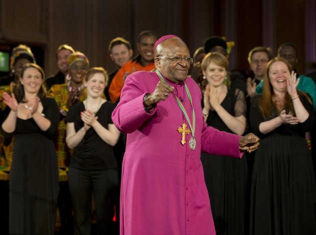 The former Anglican archbishop of Cape Town Desmond Tutu dances after receiving the 2013 Templeton Prize at the Guildhall in central London