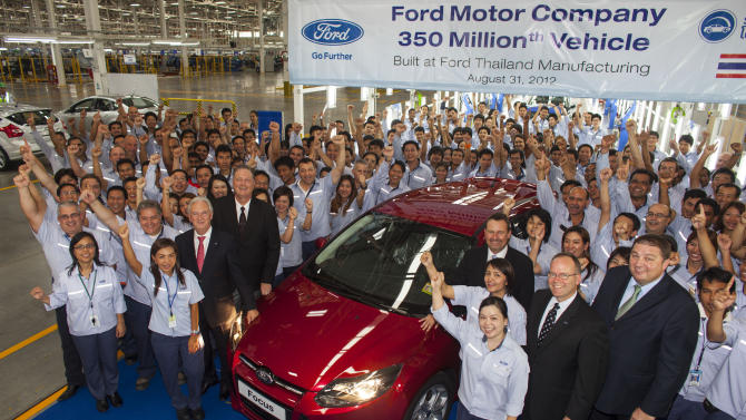 COMMERCIAL IMAGE - In this photograph taken by AP Images for Ford Motor Company, Ford Motor Company executives are joined by Ford Thailand Manufacturing employees at the company's new $450 million facility in Rayong, Thailand, Friday, Aug. 31, 2012, to celebrate a significant milestone in the company's history-production of its 350 millionth vehicle in the world through the first five months of 2012.  (David Longstreath/AP Images for Ford Motor Company)