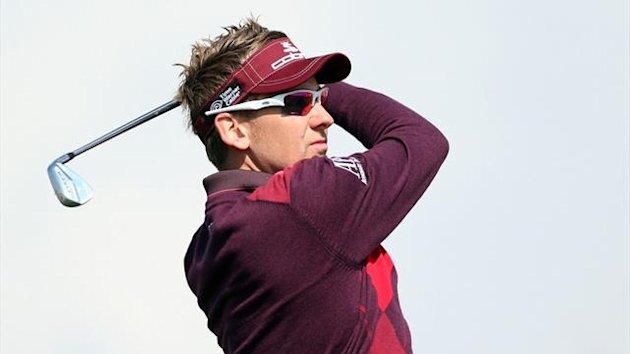 Ian Poulter watches his shot during the second round of the World Golf Championships - Accenture Match Play at the Golf Club (AFP)