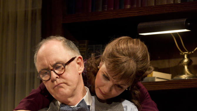 "In this theater image released by Boneau/Bryan-Brown, John Lithgow portrays columnist and political pundit Joseph Alsop, left, and Margaret Colin portrays Susan Mary Alsop in a scene from the play ""The Columnist,"" playing at the Samuel J. Friedman Theatre in New York. (AP Photo/Boneau/Bryan-Brown, Joan Marcus)"