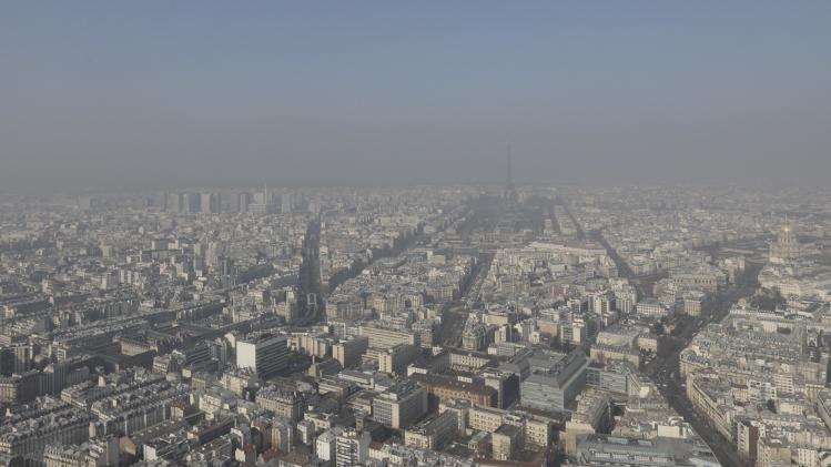 A general view shows the Eiffel tower and the Paris skyline through a small-particle haze resulting in a high level air pollution