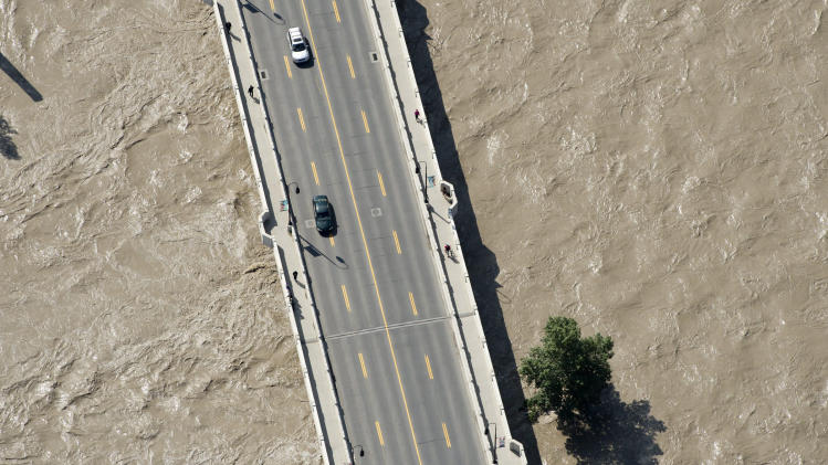 This aerial photo shows a flooded downtown Calgary, Alberta, Canada on Saturday, June 22, 2013. The two rivers that converge on Calgary are starting to recede after floods devastated much of the southern Alberta province, causing at least three deaths and forcing thousands to evacuate. The flooding forced authorities to evacuate Calgary's entire downtown and hit some of the city's iconic structures hard. The Saddledome, home to the National Hockey League's Calgary Flames, was flooded up to the 10th row, leaving the dressing rooms submerged. (AP Photo/The Canadian Press, Jonathan Hayward)