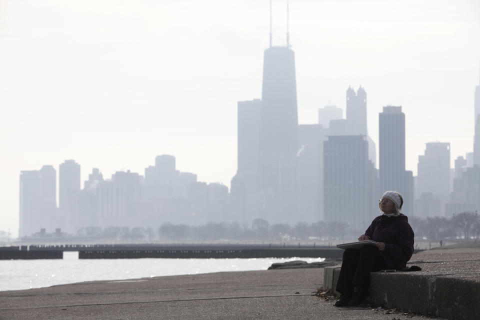 Linda Peters takes advantage of a nice weather to sketch Lake Michigan Wednesday, Feb. 1, 2012 in Chicago. (AP Photo/Kiichiro Sato)
