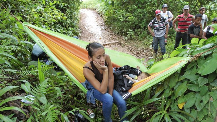 Relatives of the miners trapped inside a gold mine wait for news of their loved ones outside the gold mine in Bonanza town, northern Nicaragua