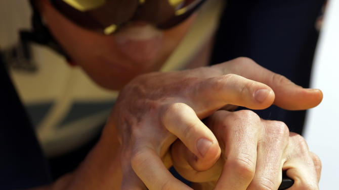 Britain's Bradley Wiggins rests his hands on his bike as he takes the start of the men's individual time trial event at the 2012 Summer Olympics, Wednesday, Aug. 1, 2012, in London. (AP Photo/Matt Rourke)