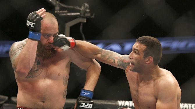 Fabricio Werdum, right, and Travis Browne fight during a UFC mixed martial arts bout on Saturday, April 19, 2014, in Orlando, Fla. Werdum won