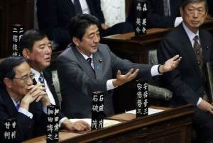 File picture shows then incoming Japanese Prime Minister and LDP leader Shinzo Abe gesturing as he takes his seat at the Lower House of the Parliament in Tokyo