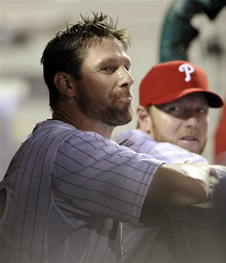 Philadelphia Phillies' Cliff Lee, left, and Roy Halladay talk in the dugout after Lee was taken out in the ninth inning of a baseball game against the New Yowk Mets, Tuesday, April 9, 2013, in Philadelphia. The Phillies won 8-3