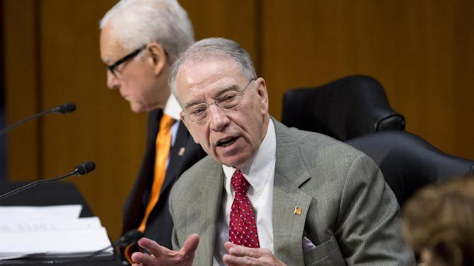 """Sen. Chuck Grassley, R-Iowa, ranking member of the Senate Judiciary Committee, defends his amendment to prohibit anyone from obtaining legal status until the Homeland Security Department has maintained """"effective control"""" of the border for six months, as lawmakers examine proposed changes to immigration reform legislation, on Capitol Hill in Washington, Thursday, May 9, 2013. Sen. Orrin Hatch, R-Utah, sits at top. Grassley's amendment was later voted down 12 to 6.  (AP Photo/J. Scott Applewhite)"""