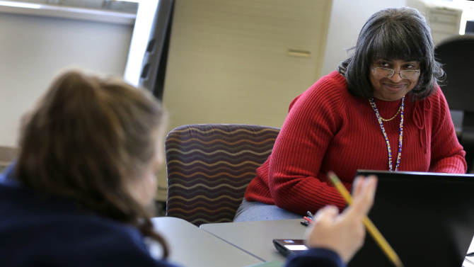 Caseworker Cheryl Boone listens to a client during a therapy session at the Johnson County Mental Health Center Wednesday, Jan. 23, 2013, in Shawnee, Kan. Lawmakers across the nation are rethinking cuts in mental health care spending in the wake of recent shootings.  (AP Photo/Charlie Riedel)
