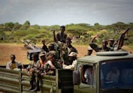 Somali soldiers cross agricultural farmland near the outskirts of Afgoye. African Union and Somali troops have captured the strategic town of Afgoye from Al-Qaeda-linked Shebab insurgents, who mostly fled in advance of the assault, an AU army spokesman told AFP