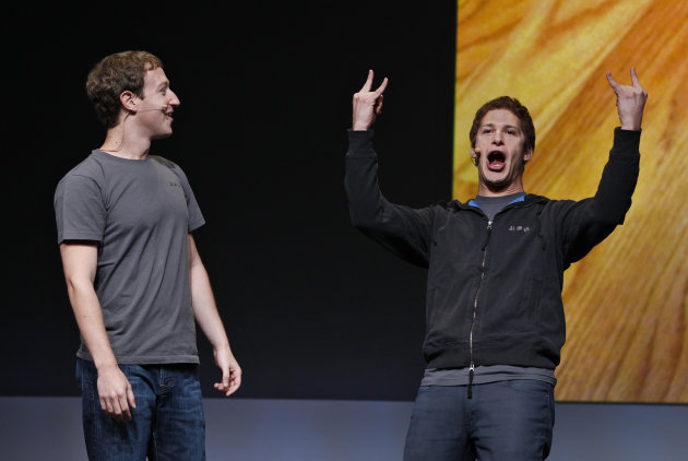 Facebook CEO Mark Zuckerberg, left, watches comedian Adam Samberg, right, of Saturday Night Live, gesture during the f/8 conference in San Francisco, Thursday, Sept. 22, 2011. (AP Photo/Paul Sakuma)