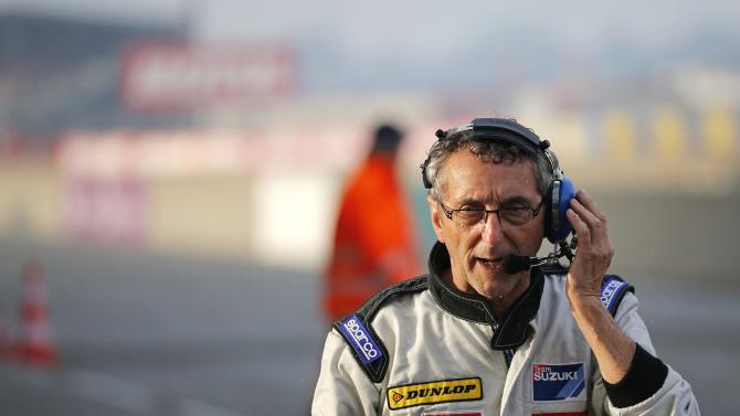 Suzuki Endurance Racing Team manager Meliand attends the 37th Le Mans 24 Hours motorcycling endurance race in Le Mans