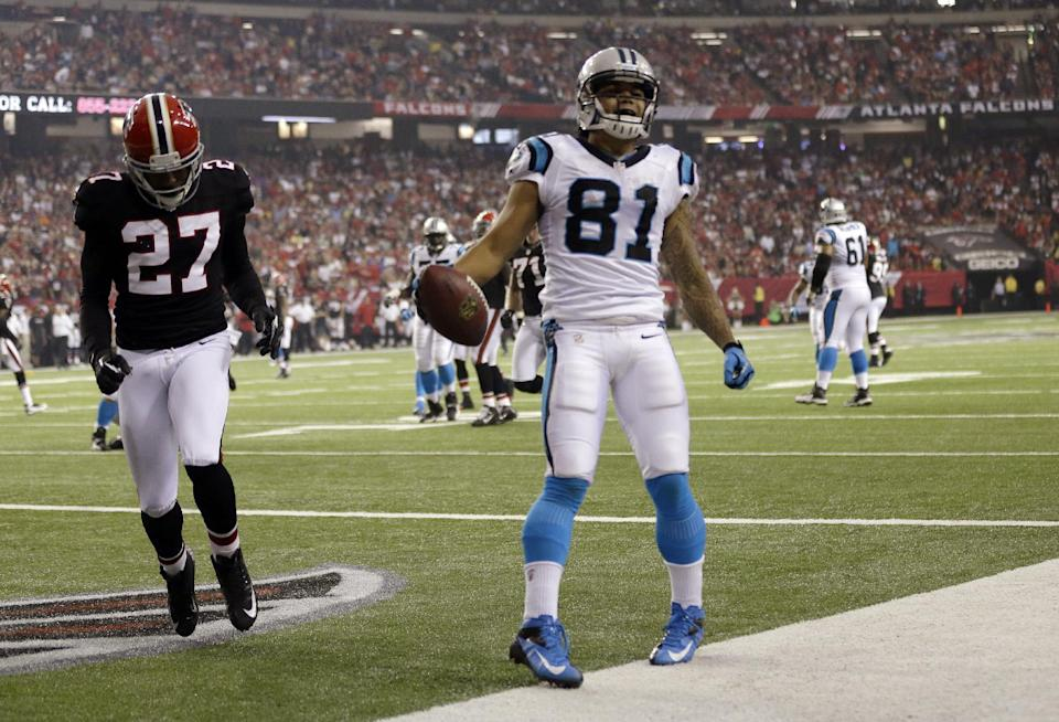 Carolina Panthers wide receiver Kealoha Pilares (81) reacts after a touchdown during the second half of an NFL football game Sunday, Sept. 30, 2012, in Atlanta. At left is Atlanta Falcons defensive back Robert McClain. (AP Photo/David Goldman)