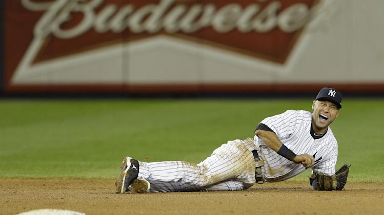 Oct. 14 New York Yankees shortstop Derek Jeter reacts after injuring himself in the 12th inning of Game 1 of the American League championship series against the Detroit Tigers early Sunday, Oct. 14, 2012, in New York.  (AP Photo/Paul Sancya )
