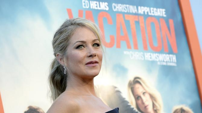 "Cast member Christina Applegate poses during during the premiere of the film ""Vacation"" at the Regency Village Theatre in the Westwood section of Los Angeles"