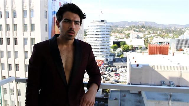 Joe Jonas' sexy sax response to fan's video